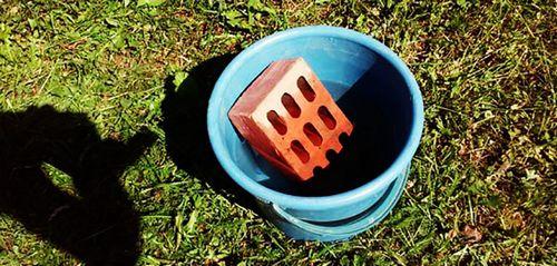 Обкладка печи для бани с помощью кирпича